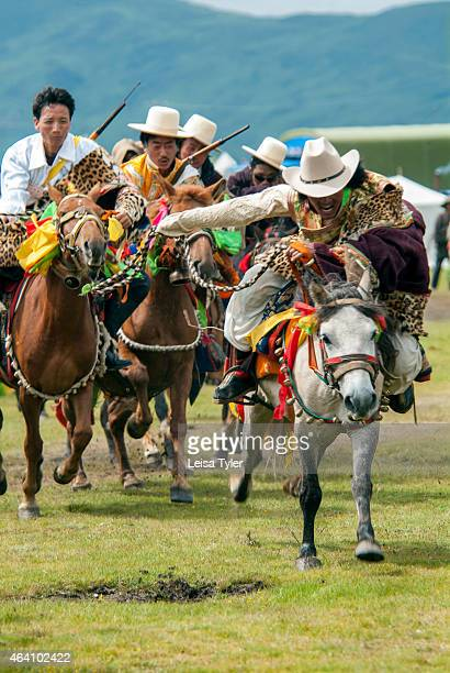 Khampa horseman race their horses at the Yushu Horse Racing Festival in Qinghai Otherwise known as Yaji the Festival of Summer Pleasures the festival...