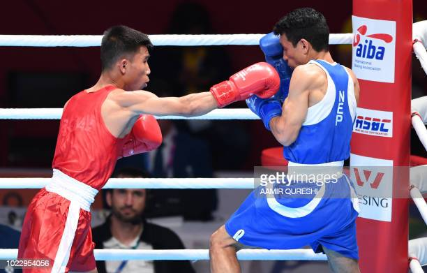 Khamphouvanh Khamsathone of Laos competes against Teja Bahadur Deuba of Nepal during the men's light fly 49kg boxing round of 32 at the 2018 Asian...