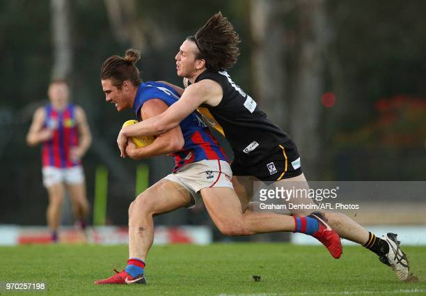 Khan Haretuku of Port Melbourne is tackled by Josh Porter of Werribee during the round 10 VFL match between Werribee and Port Melbourne at Avalon...