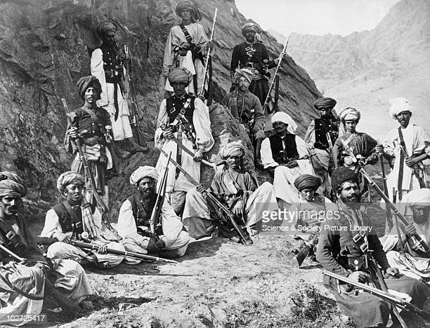 Khan of Lalpura's followers with a political officer, Afghanistan, 1878-1879. Afghan fighters with a British official . Albumen print from the Burke...