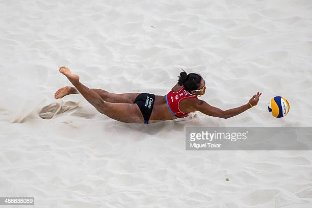 Khanittha Hongpak of Thailand dives for the ball during a qualification match against Julie Schneider and Teresa Mersman of Germany as part of the...