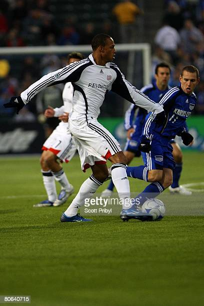 Khano Smith of the New England Revolution dribbles against the Kansas City Wizards during the game at Community America Ballpark on April 9 2008 in...