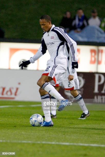 Khano Smith of the New England Revolution passes against the Kansas City Wizards during the game at Community America Ballpark on April 9 2008 in...