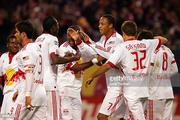 Khano Smith of the New York Red Bulls celebrates with teammates after the New England Revolution scored an owngoal to make the score 10 in favor of...