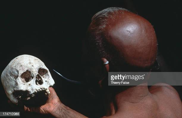 Khao Pa the old ang of Shanghah Chingyu shows a collection of skulls which he was ordered to destroy by the Christian authorities and local guerrilla...