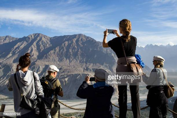 Khaplu, Pakistan, 28 September 2018. Trekkers admire the view from the Khaplu Thoqsikhar, an ancient fort of the Yabgo rulers. Khaplu is a sprawling...