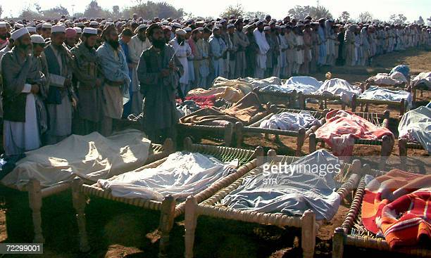 Deputy chief minister of Pakistan's North West Frontier Province SirajulHaq and tribesmen offer funeral prayers in front of dead bodies who were...