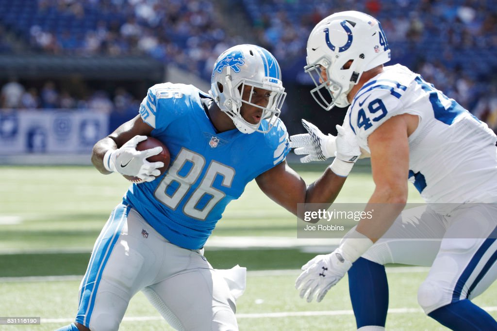 Khari Lee #86 of the Detroit Lions runs after a reception against Garrett Sickels #49 of the Indianapolis Colts in the second half of a preseason game at Lucas Oil Stadium on August 13, 2017 in Indianapolis, Indiana.