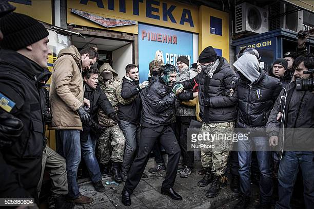 Kharkov Ukraine December 24 2014 Activists Kharkov branch right quadrant process is carried out quotpeople lustrationquot throwing the deputy of the...