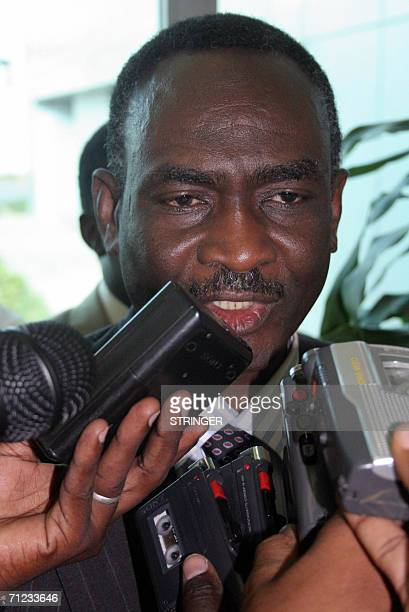 Delegation leader of the Sudan Liberation Movement Mohamed Tigani alTayeb speaks to the press upon his arrival to Khartoum airport 18 June 2006 An...