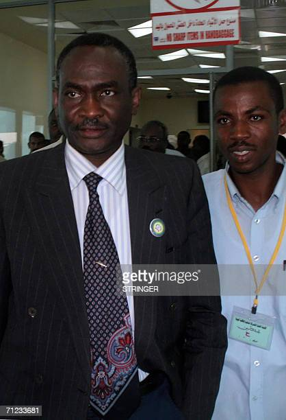 Delegation leader of the Sudan Liberation Movement Mohamed Tigani alTayeb arrives at a terminal in Khartoum airport 18 June 2006 An advance...
