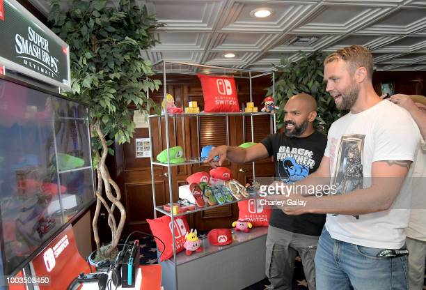 Khary Payton and Brooks Wheelan test their skills on Super Smash Bros Ultimate for Nintendo Switch at the Variety Studio at ComicCon 2018 on July 21...
