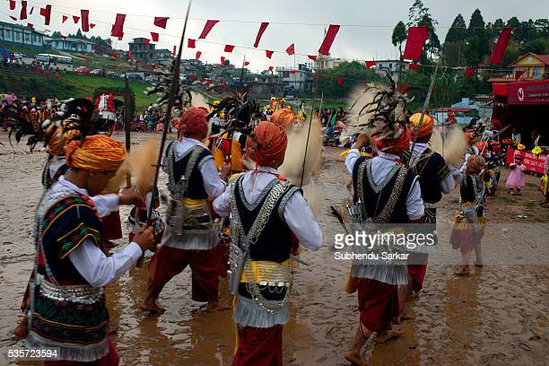 Khasi people enjoy themselves singing and dancing to traditional music near Shillong in Meghalaya Meghalaya is a state in northeast India which means...