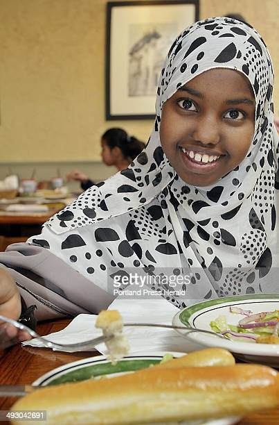 Khatro Hussein eats a salad and bread sticks as she joins a group of King Middle School students for lunch at the Olive Garden restaurant in South...