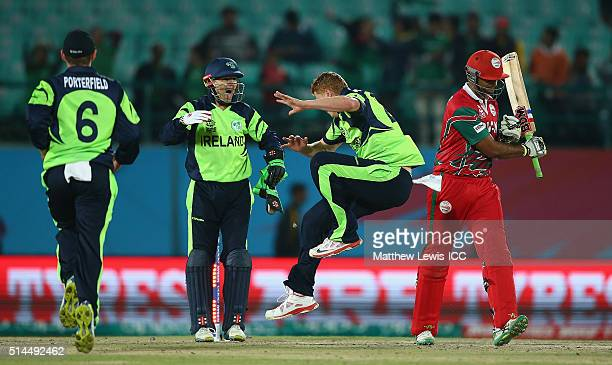Khawar Ali of Oman almost hits Kevin O'Brien of Ireland with his bat after he was bowled during the ICC Twenty20 World Cup match between Ireland and...