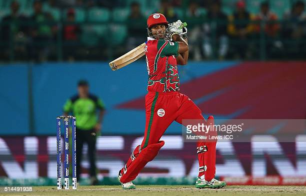 Khawar Ali of Oman hits the ball towards the boundary during the ICC Twenty20 World Cup match between Ireland and Oman at the HPCA Stadium on March 9...