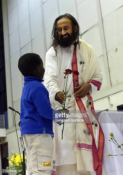 Indian religious leader Sri Sri Ravi Shankar attends 23 May 2006 a public gathering in his honour at Oliver Thambo hall in the township of...
