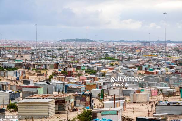 khayelitsha township corrugated iron shacks - slum stock pictures, royalty-free photos & images