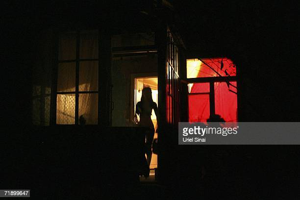 Khazak prostitute stands in the door of a brothel August 10, 2006 in Almaty in the central Asian country of Kazakhstan. Fifteen years after the...
