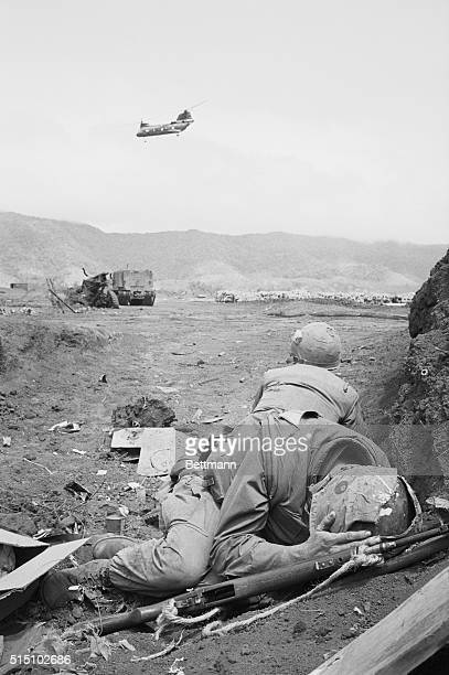 Khe Sanh a Pilot's Nightmare Khe Sanh South Vietnam Marines duck as a helicopter runs the gauntlet of enemy fire to land at Khe Sanh Communist...