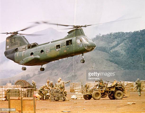 A CH46 helicopter prepares to pick up a load of supplies at Khe Sanh to be delivered to units of outlying post
