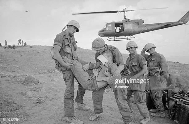 5/1967 Khe Sanh South Vietnam A wounded Marine is carried by his comrades toward a hovering helicopter April 3rd as casualties are evacuated from...