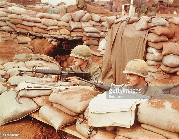 Private first class Pressley and Corporal Russell of Bravo Company 1st battalion 26th Marines watch for enemy activity at Khe Sanh PH Corporal LF...