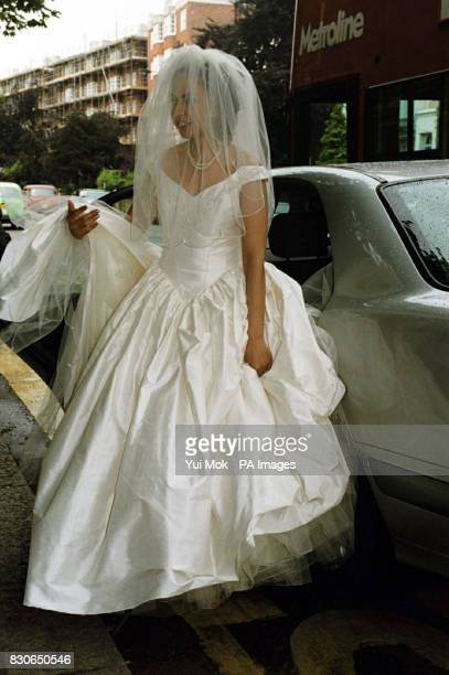 Kheira Bourahla arrives at her wedding to Julian Lloyd Webber in Kensington London The 50year cellist and brother of millionaire composer Andrew was...