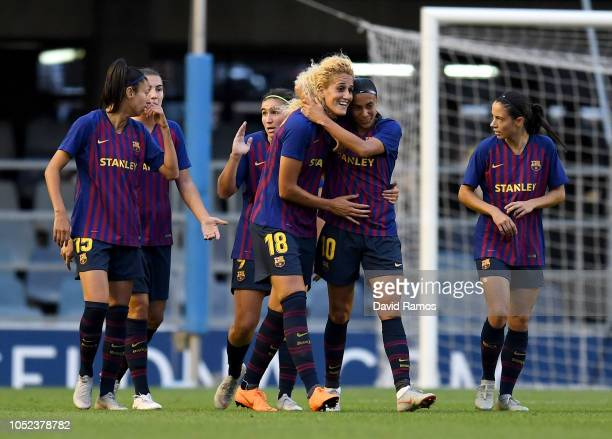 Kheira Hamraoui of Barcelona celebrates after scoring her team's first goal with her team mates during the UEFA Women's Champions League Round of 16...