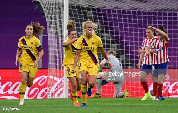 Kheira Hamraoui of FC Barcelona celebrates after scoring her team's first goal during the UEFA Women's Champions League Quarter Final between...