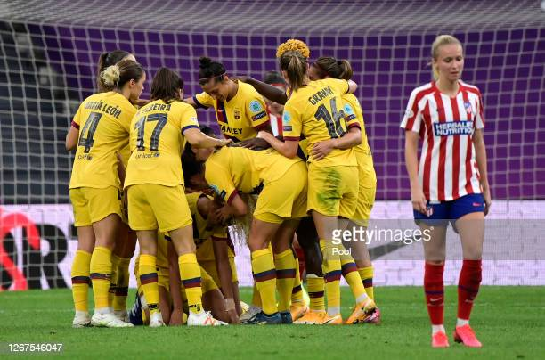 Kheira Hamraoui of FC Barcelona celebrates with teammates after scoring her team's first goal during the UEFA Women's Champions League Quarter Final...