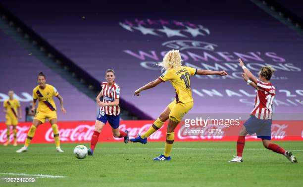 Kheira Hamraoui of FC Barcelona scores her team's first goal during the UEFA Women's Champions League Quarter Final between Atletico Madrid Women and...