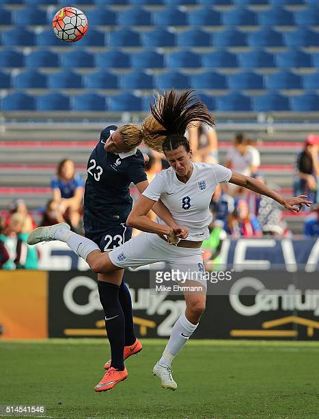 Kheira Hamraoui of France and Jill Scott of England fight for a ball during a match against in the 2016 SheBelieves Cup at FAU Stadium on March 9...