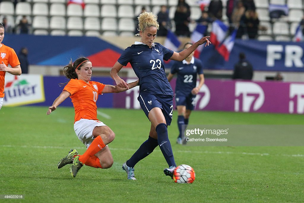 Kheira Hamraoui #23 of France controls the ball against Danielle van de Donk #10 of Netherlands during the international friendly game between France and Netherlands at Stade Jean Bouin on October 23, 2015 in Paris, France.