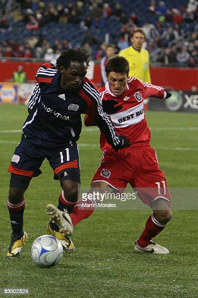 Kheli Dube of the New England Revolution and John Thorrington of the Chicago Fire battle for the ball during the game played at Gillette Stadium on...