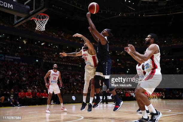 Khem Birch of Canada and Myles Turner of the USA compete for the ball during the International Friendly Basketball match between Canada and the USA...