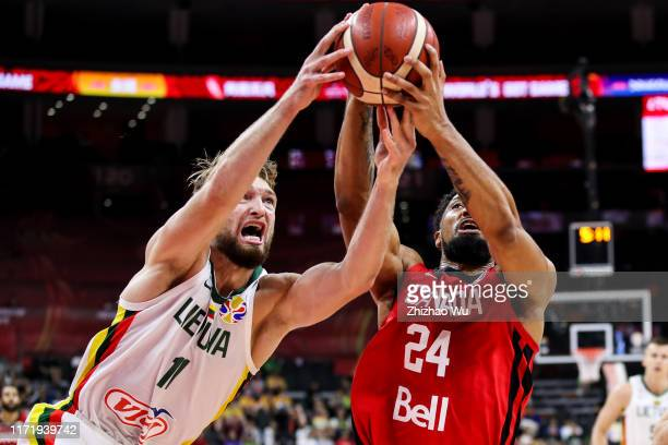 Khem Birch of Canada competes for the ball with Domantas Sabonis of Lithuania during the 2019 FIBA World Cup, first round match between Lithuania and...