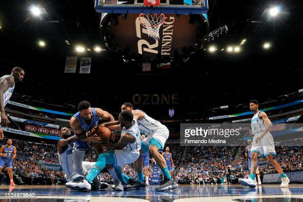Khem Birch of the Orlando Magic and Kemba Walker of the Charlotte Hornets go for a loose ball during the game on February 14 2019 at Amway Center in...