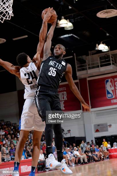 Khem Birch of the Orlando Magic blocks the shot by Milton Doyle of the Brooklyn Nets during the 2018 Las Vegas Summer League on July 6 2018 at the...