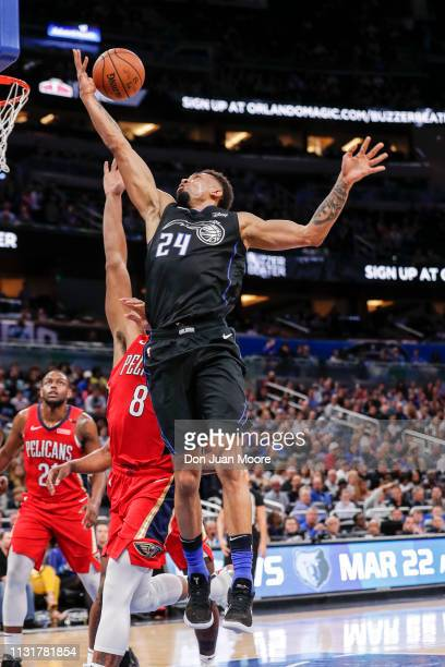 Khem Birch of the Orlando Magic drives to the basket over Jahlil Okafor of the New Orlean Pelicans during the game at the Amway Center on March 20...