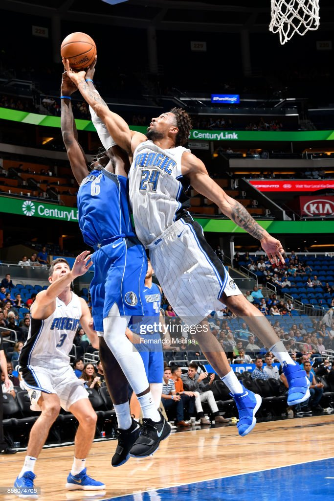 Khem Birch #24 of the Orlando Magic goes up for a rebound against the Dallas Mavericks during a preseason game on October 5, 2017 at Amway Center in Orlando, Florida.