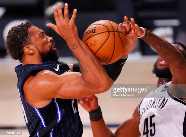 Khem Birch of the Orlando Magic is fouled by Donta Hall of the Brooklyn Nets during the second half at AdventHealth Arena at ESPN Wide World Of...