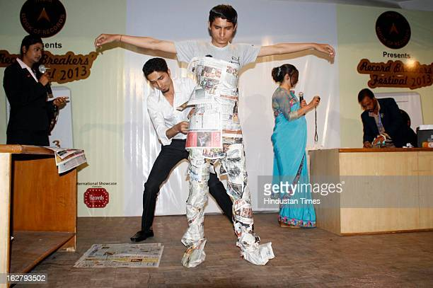 Khemraj Bharadwaj Pushpender broke the record of Fastest time to wrap a person in newspaper during Records breaking festival organised by India Book...