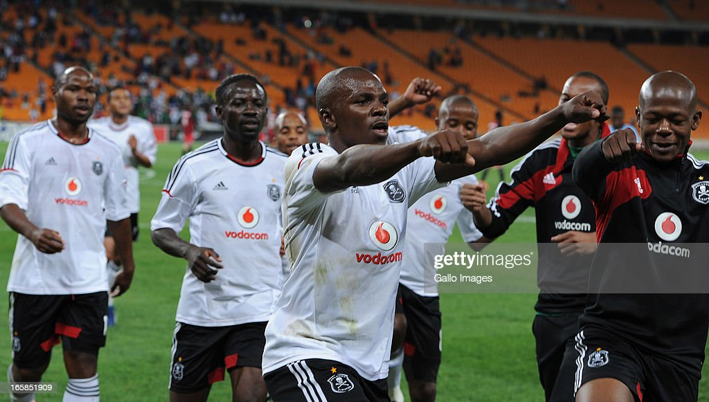 Khethowakhe Masuku celebrating his goal with team mates during the CAF Confedaration Cup match between Orlando Pirates and Zanaco at FNB Stadium on April 06, 2013 in Johannesburg, South Africa.