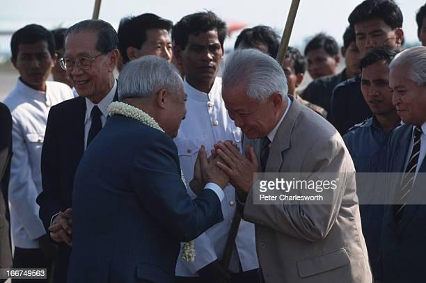Khieu Samphan greets King Norodom Sihanouk on his arrival at Pochentong Airport..