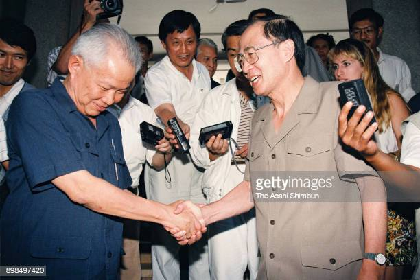 Khieu Samphan representative of the Khmer Rouge and the United Nations Transitional Authority in Cambodia special representative Yasushi Akashi shake...