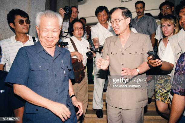 Khieu Samphan representative of the Khmer Rouge and the United Nations Transitional Authority in Cambodia special representative Yasushi Akashi are...
