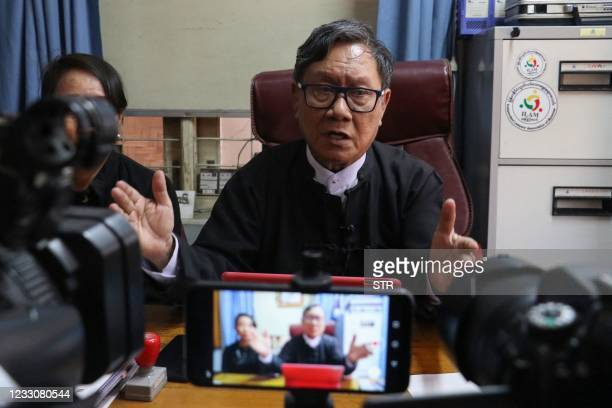 Khin Maung Zaw and Min Min Soe , lawyers representing detained Myanmar leader Aung San Suu Kyi, address members of the media at Khin Maung Zaw's...