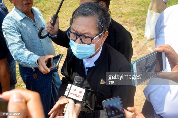 Khin Maung Zaw, lawyer for detained civilian leader Aung San Suu Kyi and President Win Myint, answers questions from the media after leaving...