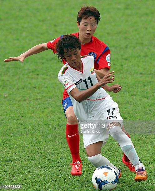 Khin Moe Wai of Myanmar is checked by Kim Hye Ri of Korea Republic during the AFC Women's Asian Cup Group B match between Korea Republic and Myanmar...